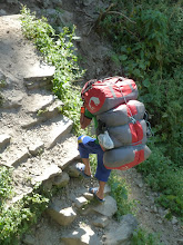 Photo: Our porter with personal gear for 2 and 6 days food for 4