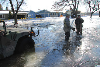 Photo: U.S. Army Staff Sgt. Robin Mattson speaks with a local resident while patrolling the streets of  Moorhead, Minn. during flood fighting operations Mar. 28, 2009.  Approximately 500 members of the Minnesota National Guard, under the direction of the Governor of Minnesota, continue to provide assistance to civil authorities in support of flood fighting efforts during the record high flood.  (U.S. Air Force Photo by MSgt Jason W. Rolfe) (Released)