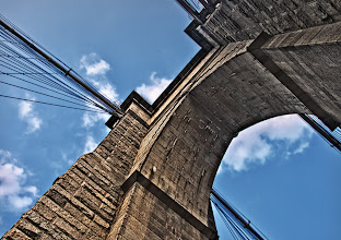 Photo: Earlier today +Brian Matiash posted an image of the Brooklyn Bridge in a posting he called 'Seeing Differently'. The picture showed a unique view of the bridge that isn't often seen. When I saw the picture I remembered that I had a similar (but different) view of the bridge that I had been sitting on for a while and his posting motivated me to see if I could 'finish' the image.  I took this shot a couple of years ago when I was in New York on business. When I took the shot, I fired off 3 quick brackets with the thought that I would create an HDR image from them. I tried a few different times but was never happy with the result. One of the issues was that Photomatix wasn't doing a great job of aligning the images. I decided to try the HDR in Photoshop because I think their alignment algorithms work better (at least some of the time).  The idea was to merge in Photoshop and then use some additional filters (mostly onOne's PhotoTools) to finish the image. I was pretty happy with the merging that Photoshop did and PhotoTools help me improve it from there. I debated about going with a black and white HDR using Silver Efex Pro 2, but decided for the time being to just go with the color version.  I'd like to thank Brian for giving me the motivation to work on this image. I don't know when I'll be back in New York and it is fun reviewing images that I shot in the past but perhaps overlooked.