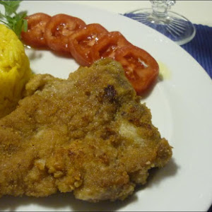 Breaded Chops with Saffron Rice
