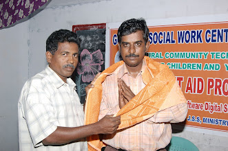 Photo: Mr.Arul,Assistant programme officer-JSS being adorned with a shawl