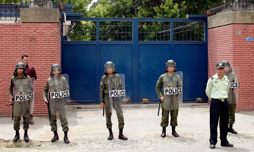 """Photo: Iranian riot policemen stand guard outside the British embassy in Tehran on June 15, 2009 during a protest by supporters of President Mahmoud Ahmadinejad against European interference in the Islamic Republic's latest election results. EU foreign ministers expressed """"serious concern"""" at Tehran's crackdown on opposition protesters and called for a probe into the conduct of the June 12 presidential election. AFP PHOTO/ATTA KENARE (Photo credit should read ATTA KENARE/AFP/Getty Images)   Original Filename: DV_To_Getty_2817652_0.jpg"""