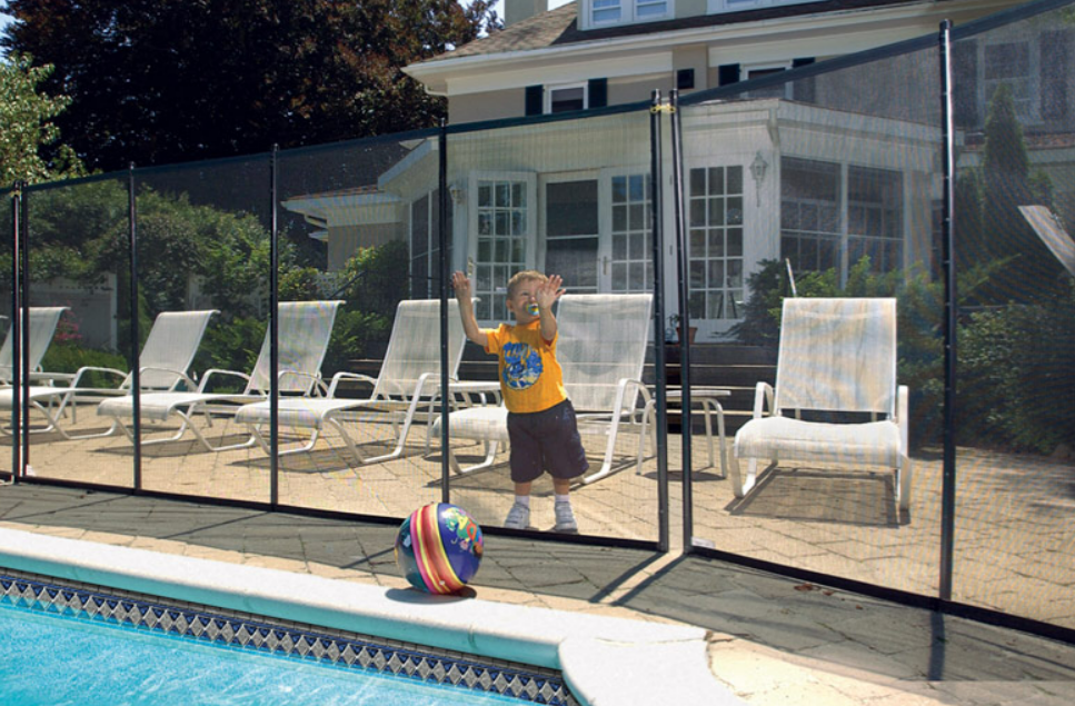 A child cannot access a ball next to a pool because of a BABY-LOC pool safety fence.