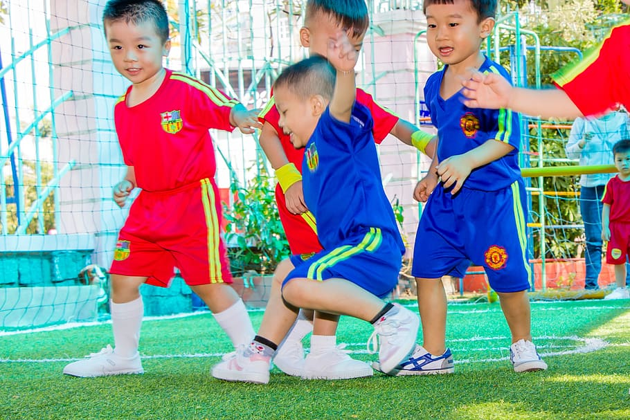 Little kids having fun on a soccer field  (Soccer for 3 and 4-year-olds)