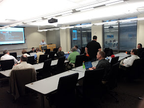 Photo: QCDUG members filing into the room awaiting the presentations