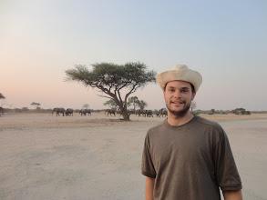 Photo: Adam on the same turf as a buncha elephants