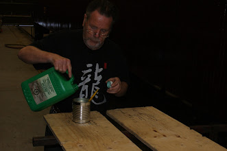 Photo: Jim prepping to paint wood preservative on the new plywood floorboards.  Photo by Jack Loucks
