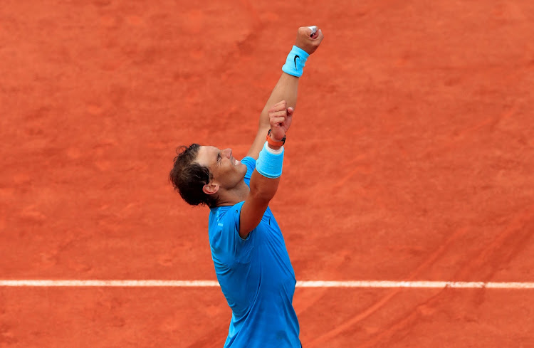 Spain's Rafael Nadal celebrates after winning the French Open final against Austria's Dominic Thiem on June 10, 2018.