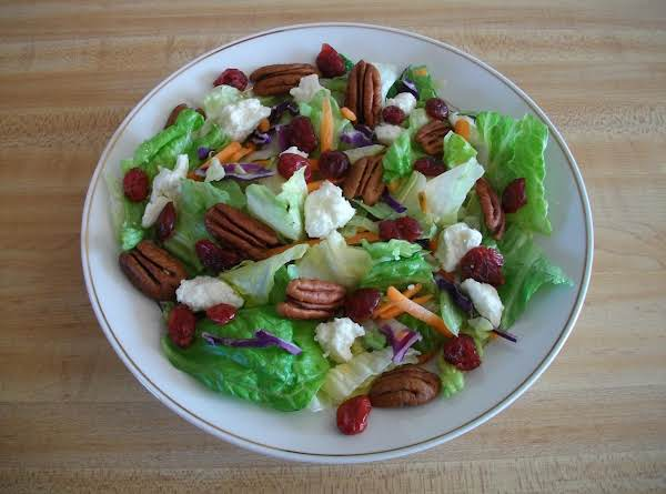 Salad Made With Store Bought (bagged) Iceberg Lettuce/romaine Lettuce, Shredded Cabbage And Carrots. Along With Feta Cheese, Dried Cranberries And Whole Pecans.