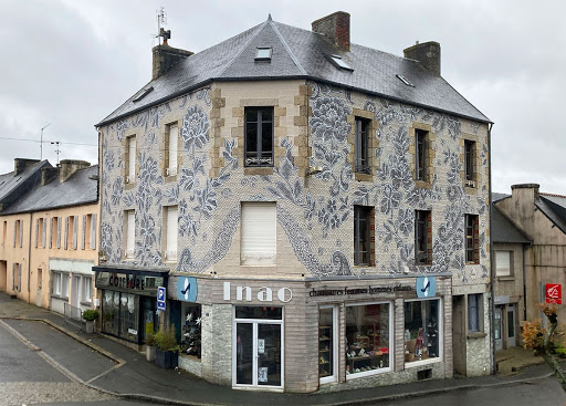 Artist Transforms Building Façade in France With Delicate Painted Lace