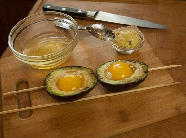 Using a small serving spoon, carefully place an egg yolk into each of the...