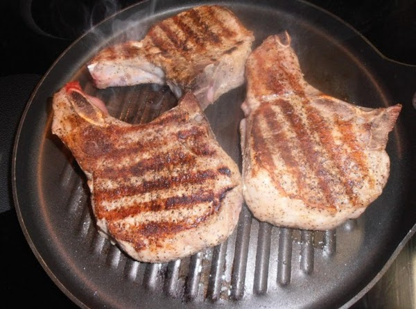 preheat oven to 350 degrees.  on a hot grill pan, grill chops for...