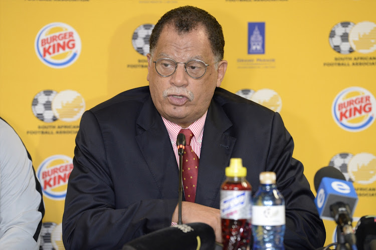 SA Football Association president Danny Jordaan addresses the media at the OR Tambo International Airport in Johannesburg on February 20 2019.