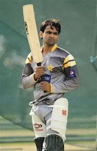 Photo: Pakistan's batsman Mohammad Hafeez holds his bat during a practice session ahead of the fourth one day international cricket match against Sri Lanka in Colombo, Sri Lanka, Friday, June 15, 2012. (AP Photo/Eranga Jayawardena)