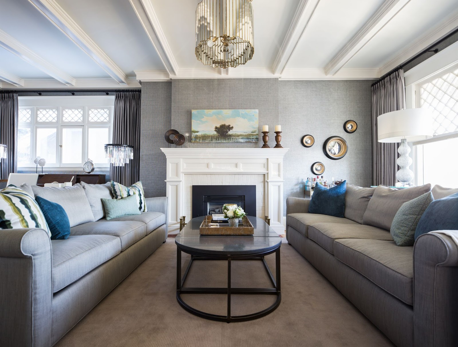 leanne bunnell interiors home renovation mirror chandelier white fireplace traditional ceiling calgary