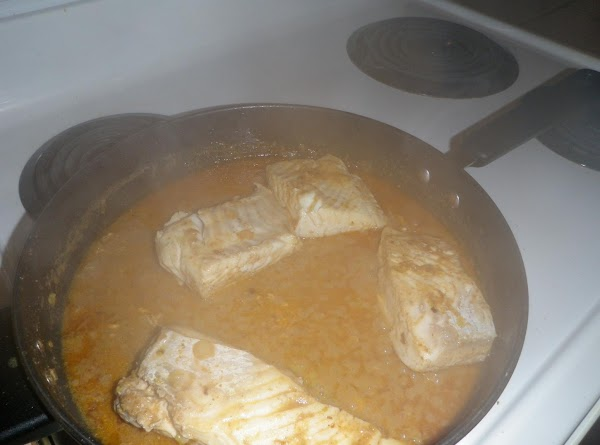 Add halibut pieces, cover with a lid and saute gently over medium heat (about...