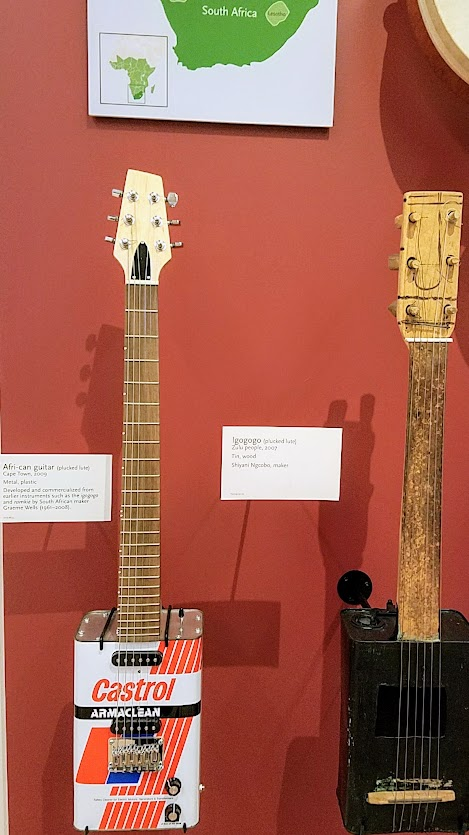 Music Instrument Museum (MIM) Geographic galleries, Afri-can guitar from Cape Town and Igogogo from the Zulu people, both examples of plucked lutes