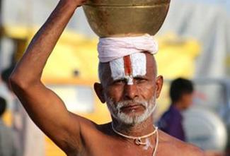 indian man carrying pot