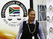 National Tresury Chief Director for Communications, Phumza Macanda smiles as she leaves the state capture inquiry on Monday after testifying.