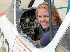Photo: Lydia enjoys climbing in one of the planes on display at the Israeli Air Force Museum.