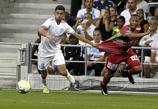 Andile Jali of KV Oostende pulls away from Morgan Sanson of Olympique Marseille in a Europa League qualifying match. Jali's contract with Oostende ends in June.
