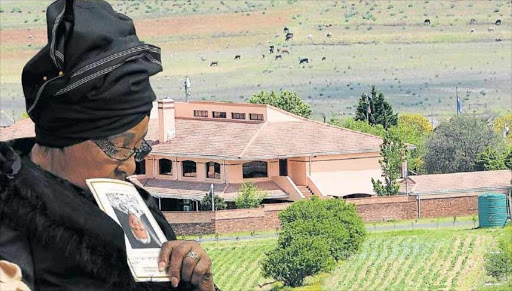 Winnie Madikizela-Mandela walks past Mandela's home in Qunu. Picture: DAILY DISPATCH
