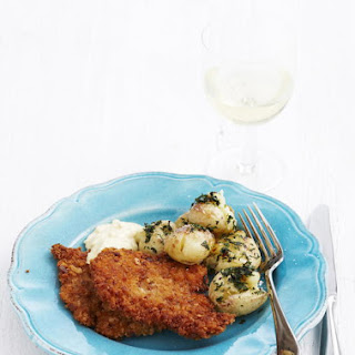 Breaded Pork Chops with Garlic Mayo and Smashed Potatoes.