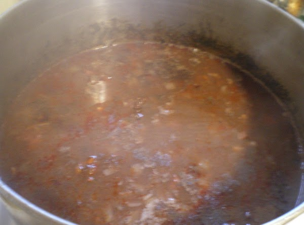 In a large dutch oven add rinsed and soaked black beans, salsa, onion, chorizo...