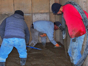 Photo: Race Hutch gets its cement floor on the lower level.
