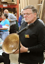 Photo: Dick Webster shows his large, bark-edge oak bowl.