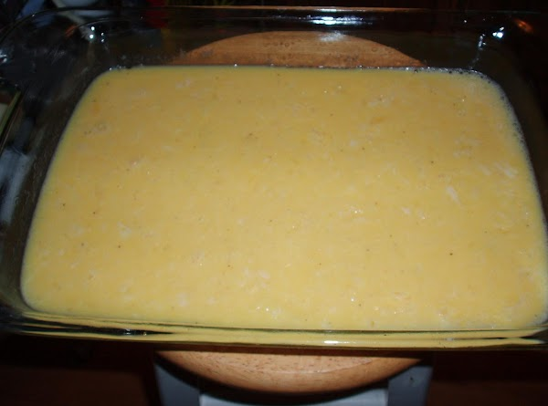 Pour melted butter into a glass 9x13 inch baking dish. In a large bowl,...