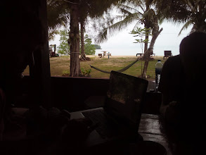 Photo: JM and I working on Peace Corps video for government offices, backed by a cloudy day on the Andaman
