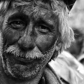 A farmer by Elias Spiliotis - People Portraits of Men ( farmer, black & white, old man, smiling, portrait, face, people,  )