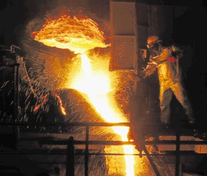 An employee works in a ferronickel smelter. Picture:REUTERS