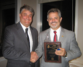 Photo: Incoming Rotary Club President (Year 2012-2013) Eric Sanders presents the CLUB PRESIDENT Plaque to 2011-2012 Rotary Year Club President Rev. Dennis Robinson in recognition of his excellent leadership as President of the Rotary Club of DeBary-Deltona. - June 8, 2012