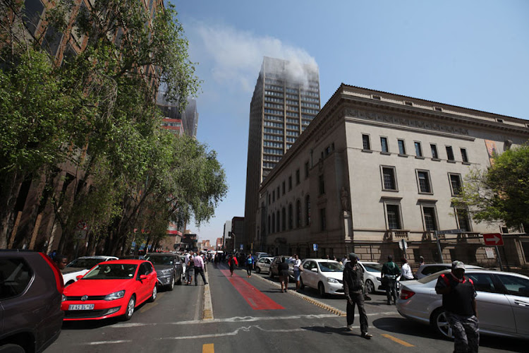 The building that houses the Gauteng department of health in Johannesburg CBD was on flames as the paramedics and fire fighters try to extinguish fire on September 5 2018.