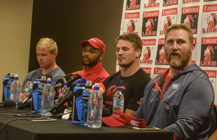 Ross Cronje of the Lions, Lionel Mapoe of the Lions, Captain Jaco Kriel of the Lions and Coach Johan Ackermann of the Lions during the Emirates Lions team announcement at Emirates Airline Park on August 03, 2017 in Johannesburg, South Africa.