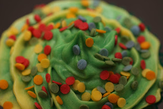Photo: A cupcake with a yellow and green icing