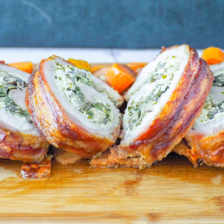 Bacon Wrapped Pork Loin Stuffed with Herbed Goat Cheese, Spinach, & Mushrooms.