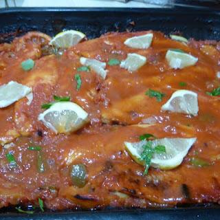 Baked haddock in Tomato and Lemon Sauce.