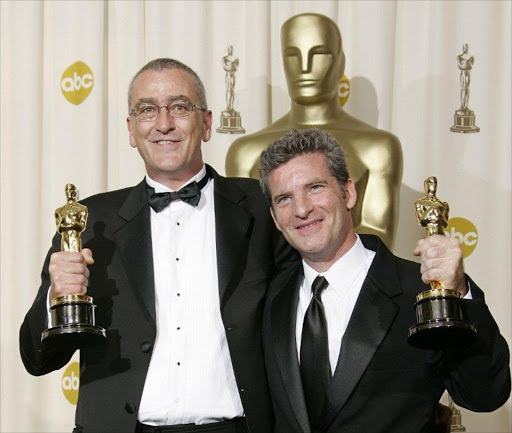 Mike Hopkins and Ethan Van Der Ryn pose with their Best Sound Editing Oscar for King Kong. File picture