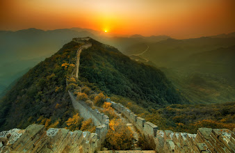 Photo: Great Wall of China  More onhttp://www.StuckInCustoms.com  Wow I am alone here. As I walk along this ancient, original stretch of the Great Wall, I feel ghosts haunting the old towers and little enclaves.  I finally found an extremely remote part that is far enough away from civilization to stay pure. The ruins of the wall in this area has been overgrown with vegetation. When you walk along the top, you have to snake your way between huge bushes and all sorts of trees. Stairs and parts of the walkways have crumbled away in the past thousand years. The old towers are slopingly fragmenting as lichens and moss cover parts of the stone that are decaying away.  This has only reminded me that the main tourist part of the Great Wall is a very tiny stretch that has been re-built in recent years… so it is all fake and kind of Disney-wall. I don't think I like that...  I've walked from tower to tower throughout the day, looking at the sinuous wall as it snakes over the mountains. It's so huge that I won't even begin to come up with analogies… but, speaking of snakes, a family here told me to watch out for them. I kept that in mind as I hiked back in the pure black of night. I had a little flashlight to keep me company, along with my music. I didn't see any snakes, and I didn't fall down, so all together it was a great day and night.  I also made a behind-the-scenes video - it is here on my stream now :)  #SICInDatabase