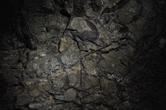 Photo: In this pattern, I saw a mask. This piece is decorated with quartzite fragments.