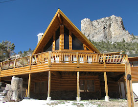 "Photo: Classic Log cabin ""A"" frame with mountain"