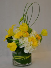 Photo: Cream, Yellow in Leaf Wrapped Vase, $40.00 each.