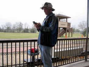 Photo: Norman Beveridge texting while the rain comes down.   2014-0315 DH3