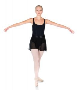 Beautiful female ballet dancer isolated on a white background. Ballerina is wearing a black leotard pink stockings pointe shoes and a black dress.