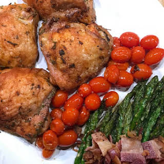 Chicken Asparagus and Tomatoes Sheet Pan Dinner.