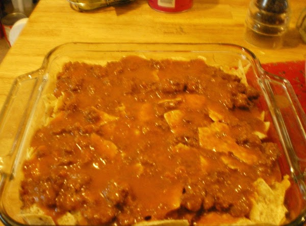 Pour the rest of the chili mixture on top of the chips and bake...
