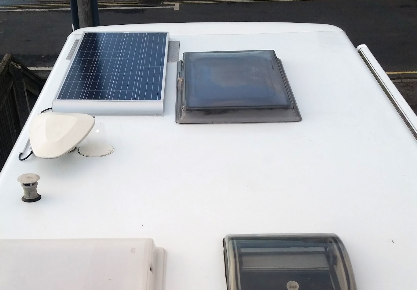 150W solar panel looked big in the shop but now seems insignificant on Humberto's roof, Room for a few more I'd say.